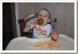 Aidan eating his Mama Mancini Meatball